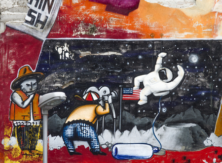 transforms: BELGRADE, SERBIA - APRIL 23, 2014: Graffiti on the walls in Savamala in Belgrade. Project Red Bull Door Deco transforms old and decayed doors at Savamala into creative field for graffiti artists