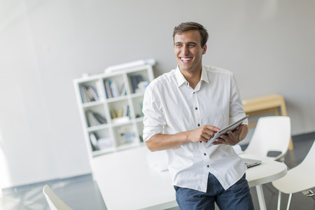 business casual: Young man with tablet in the office