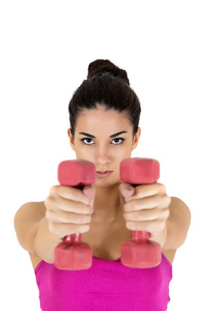Young woman with dumbbells photo