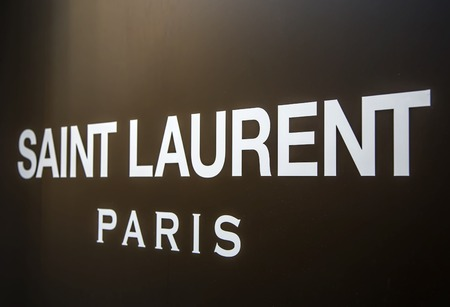 laurent: MILAN, ITALY - MARCH 9, 2014: Detail of Saint Laurent shop in Milan. is a luxury fashion house founded by Yves Saint Laurent at 1962 in PAris, France.