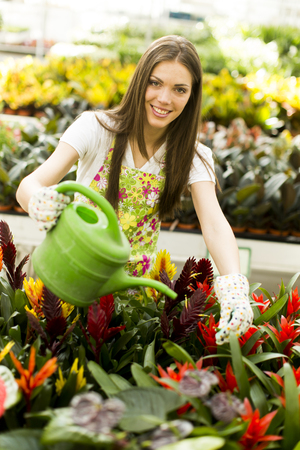 Young woman in flower garden photo