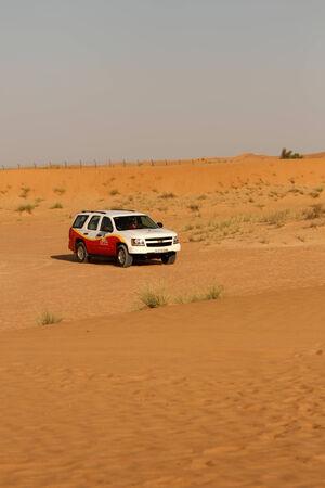Dubai, United Arab Emirates - November 16, 2010: Desert driving near Dubai. Wild offroad 4x4 drive through the dunes of the Dubai Desert is a popular tourist attraction.