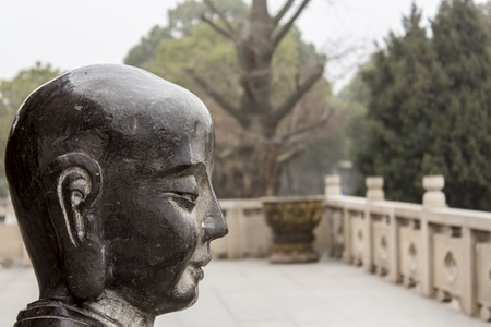 SUZHOU, CHINA - FEBRUARY 2, 2014: Sculpture at Humble Administrators Garden in Suzhou. This garden, along with other classical gardens of Suzhou, was proclaimed a UNESCO World Heritage Site at 1997.