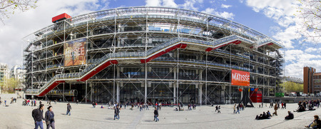 georges: PARIS, FRANCE - APRIL 11, 2012: Unidentified people in front of Centre Georges Pompidou in Paris, France. The postmodern structure completed in 1977 is one of most recognizable landmarks in Paris. Editorial