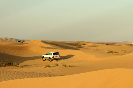 4 wheel: Dubai, United Arab Emirates - November 16, 2010: Desert driving near Dubai. Wild offroad 4x4 drive through the dunes of the Dubai Desert is a popular tourist attraction. Editorial