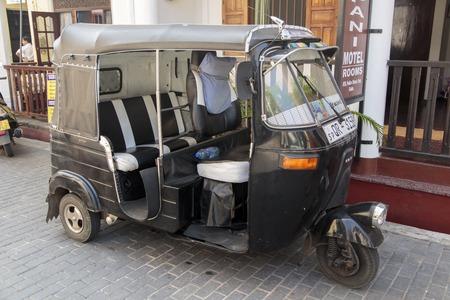 bajaj: GALLE, SRI LANKA - JANUARY 24, 2014: Auto rickshaw or tuk-tuk on the street of Galle. Most tuk-tuks in Sri Lanka are a slightly modified Indian Bajaj model, imported from India.