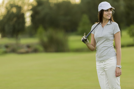 woman golf: Young woman playing golf