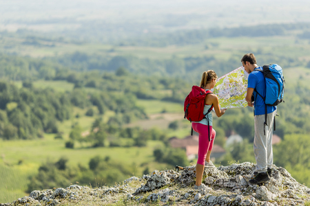 male and female: Young couple hiking on the mountain Stock Photo