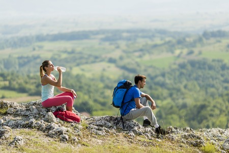 Young couple hiking on the mountain photo