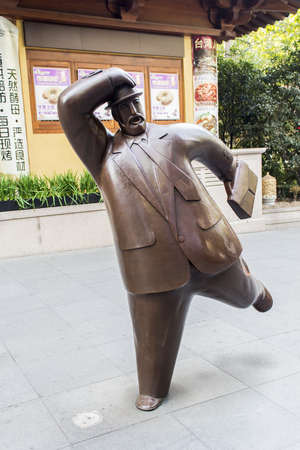 rotund: Man sculpture made of reinforced fiberglass in Shanghai, China at November 16, 2013. Sculpture is made by Wu Zhenwei Wu who has constructed more than 50 rotund gentlemen Editorial
