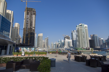 accommodate: DUBAI, UAE - JANUARY 16, 2014: Unidentified people in Dubai Marina in Dubai, UAE. When the entire development is complete, it will accommodate more than 120,000 people. Editorial