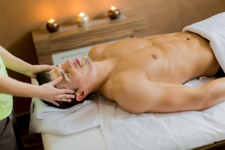 Young man having a facial massage photo