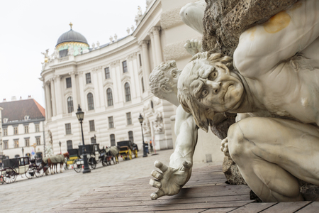 mastery: Mastery of the Land fountain at Michaelerplatz in Vienna. It was designed in 1897 by Edmund Hellmer and symbolizes the Austrian army. Stock Photo