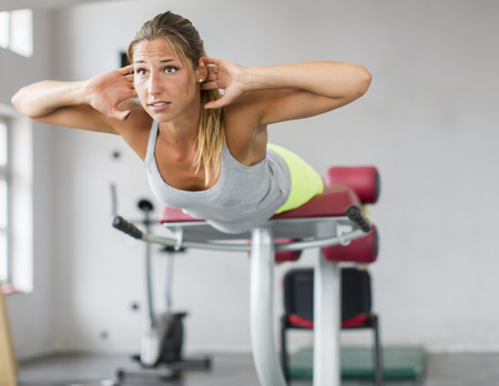 Pretty young woman training in the gym photo