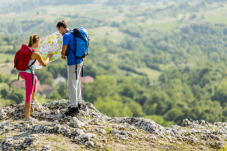 Young couple hiking on the mountain Stockfoto