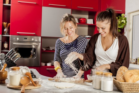 young woman: Young women in the kitchen Stock Photo