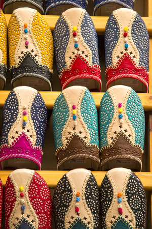 souk: Colorful babiuches at souk in Fez, Morocco
