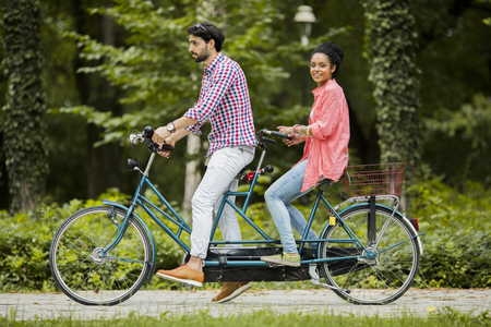 Young couple riding on the bicycle photo