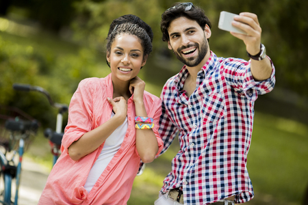 Young couple taking photo with mobile phone photo