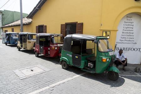 galle: GALLE, SRI LANKA - JANUARY 24, 2014: Auto rickshaws or tuk-tuks on the street of Galle. Most tuk-tuks in Sri Lanka are a slightly modified Indian Bajaj model, imported from India. Editorial