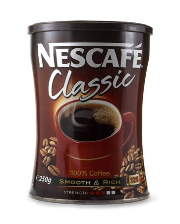 BELGRADE, SERBIA - OCTOBER 15, 2014: Can of Nescafe on white background. Nescafe is a brand of instant coffee made by Nestle.