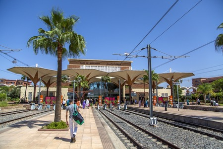 endpoint: MARRAKESH, MOROCCO - SEPTEMBER 11, 2014: Unidentified people on the train station in Marrakesh, Morocco. Train station was opened on August 10, 2008 and now is southern end-point of the Moroccan railway system.