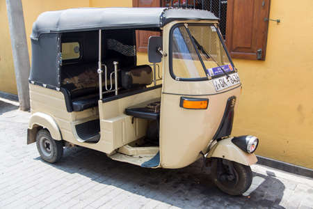bajaj: GALLE, SRI LANKA - JANUARY 24, 2014: Auto rickshaws or tuk-tuks on the street of Galle. Most tuk-tuks in Sri Lanka are a slightly modified Indian Bajaj model, imported from India. Editorial
