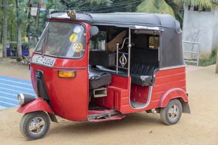 bajaj: DAMBULLA, SRI LANKA - JANUARY 27, 2014: Auto rickshaw or tuk-tuk on the street of Dambulla. Most tuk-tuks in Sri Lanka are a slightly modified Indian Bajaj model, imported from India.