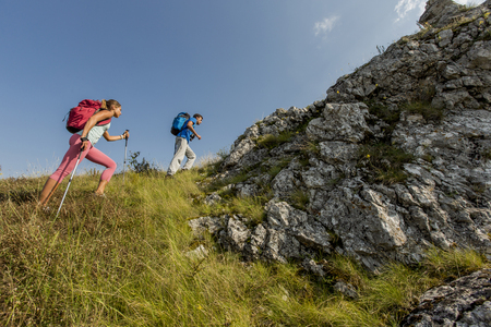 young couples: Young couple hiking on the mountain Stock Photo