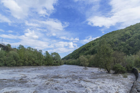 flooding: Flooding river