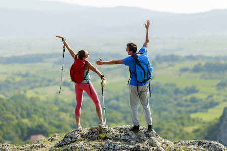 adventure travel: Young couple hiking on the mountain Stock Photo