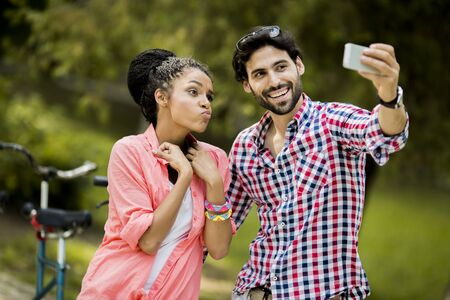 affectionate actions: Young couple taking photo with mobile phone Stock Photo