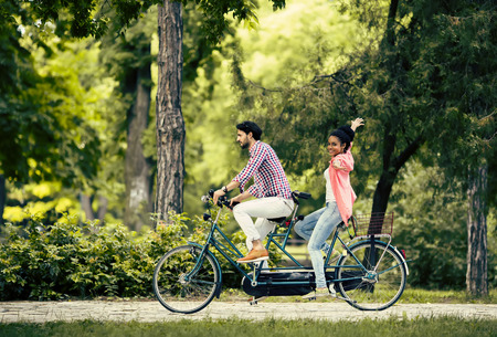 bicycles: Young couple riding on the bicycle