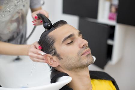 hair salon: Young man at hairdresser