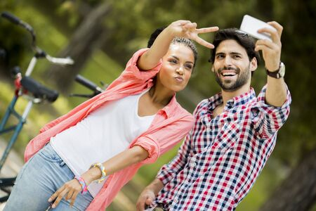 affectionate action: Young couple taking photo with mobile phone Stock Photo