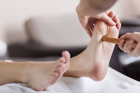 human foot: Reflexology foot massage Stock Photo