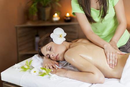 massage: Pretty young women having a massage