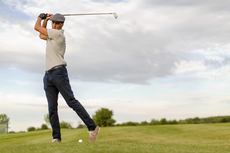 golf glove: Young man playing golf