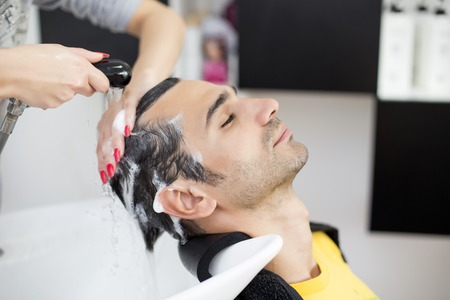 men hair style: Young man at hairdresser