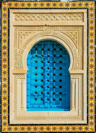 Decorated arabic style house window from Tunisia, Africa photo
