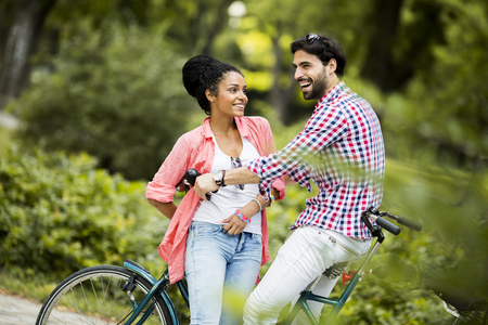 affectionate actions: Young couple riding on the bicycle