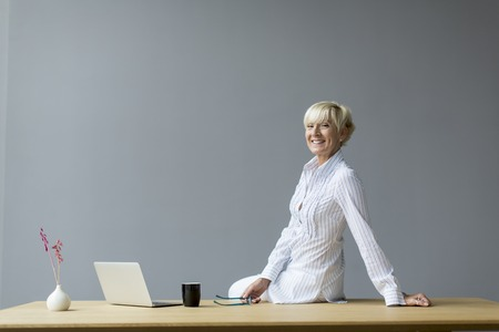 BUSY OFFICE: Woman working in the office Stock Photo