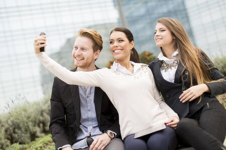 Young people taking photo with mobile phone photo