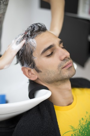 Young man at hairdresser photo