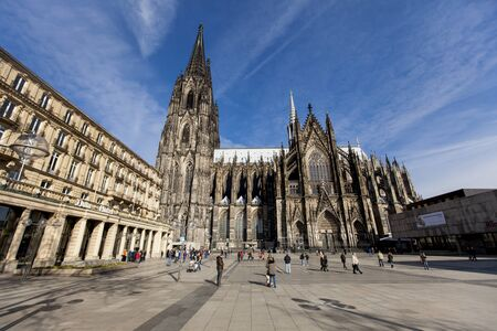 COLOGNE, GERMANY - FEBRUARY 28, 2015: Unidentified people in front of Cologne Cathedral in Germany. At 1995 cathedral was designated as UNESCO World Heritage Site.