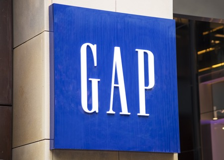 retailer: SYDNEY, AUSTRALIA - FEBRUARY 9, 2015: Detail of Gap store in Sydney, Australia. Gap is an American multinational clothing and accessories retailer,  founded in 1969.