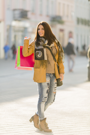 Young woman with bags in shopping photo