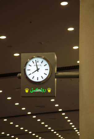 groundbreaking: DUBAI, UAE - JANUARY 29, 2014: Rolex clock at Dubai Airport. This Rolex sponsored clocks are part of a groundbreaking worldwide partnership with Dubai Airport.