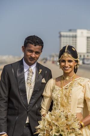 25 years old: COLOMBO, SRI LANKA - JANUARY 18, 2014: Typically, Sri Lankans marry later than people in other Asian countries. today the average age of marriage is 25 years old in Sri Lanka