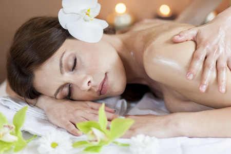 Pretty young women having a massage photo